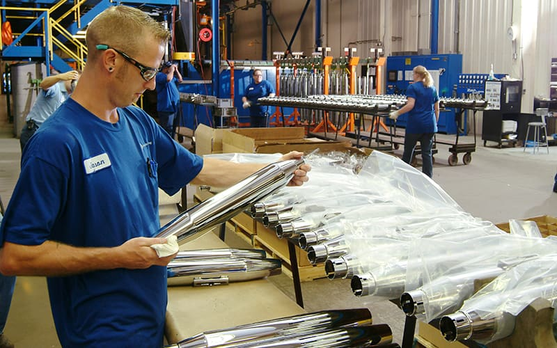 worker at assembly line with parts